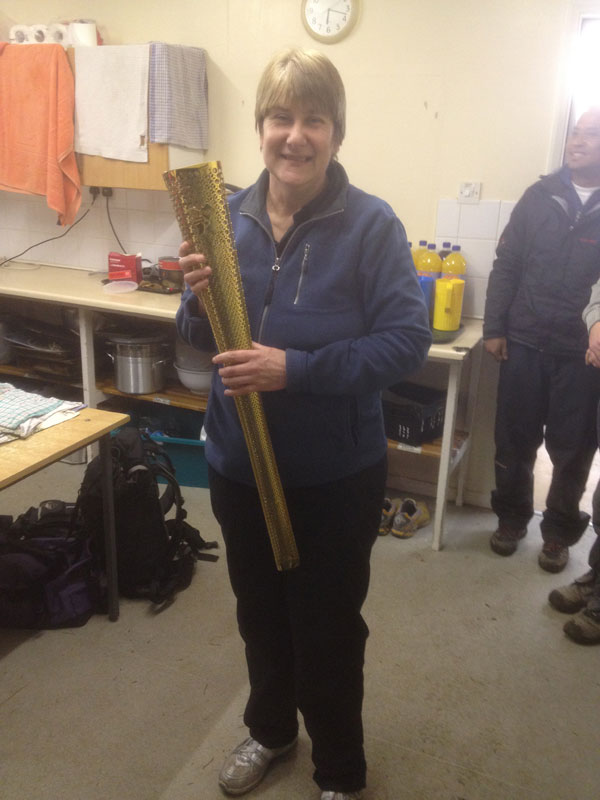 Jo Lee our fantastic cook with the Olympic Torch
